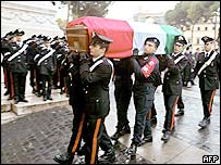 Carabinieri carry coffin