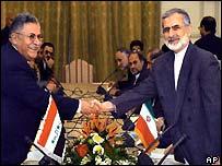President of Iraqi Governing Council, Jalal Talabani, left, who is leader of the Iraqi Patriotic Union of Kurdistan (PUK), and Iranian Foreign Minister Kamal Kharrazi