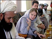 Bettina Goislard [centre] with local Afghan men