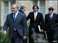 Prime Minister Jean-Pierre Raffarin leaves a meeting with the president.