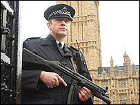 An armed British police officer outside the Houses of Parliament