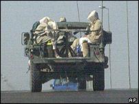 Hooded Iraqi prisoners