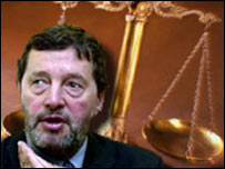 BBC graphic showing David Blunkett in front of the scales of justice