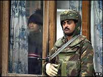 Indian soldier stands guard outside one of the houses near the Srinagar camp