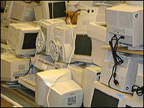 Computer monitors in a pile