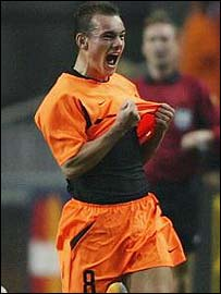 Wesley Sneijder celebrates after opening the scoring