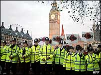 Rows of police, with protesters and Big Ben behind them