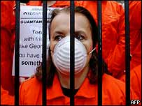 Demonstrators dressed as detainees in Guantanamo protest against the state visit of US President George Bush to Britain, November 2003