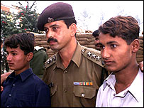 Two Pakistani boys with Indian soldier