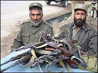 Guns left outside voter registration centre in Jalalabad
