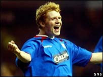 Chris Burke celebrates opening the scoring