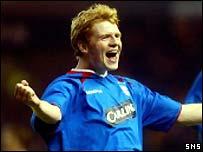 Chris Burke celebrates opening the scoring