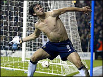 Spurs striker Helder Postiga was booked for throwing his shirt into the crowd after his goal