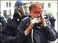 Protester held by police at Genoa G8 summit