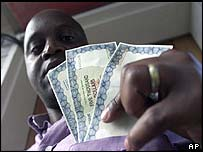 A Zimbabwean holding new temporary banknotes