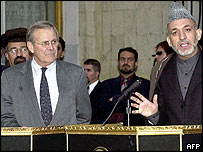 Donald Rumsfeld (L) with Hamid Karzai in Kabul