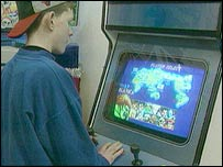 Teen playing arcade games