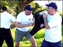 Jason Black (left) and Don Reed (right) practice hand-to-hand combat