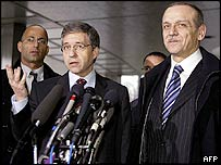 The authors of the Geneva Accord Israeli Yossi Beilin (left) and Palestinian Yasser Abed Rabbo speak to reporters after their talks with US Secretary of State Colin Powell