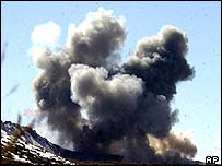 Smoke rises from Taleban and al-Qaida positions in the hills of Sirkankel, Afghanistan after heavy US bombing, March 2002