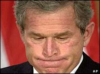 George W Bush pauses during a press conference with Tony Blair in London