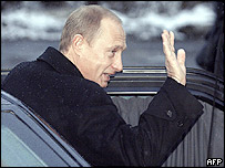 Russian President Vladimir Putin waves as he leaves a polling station in Moscow