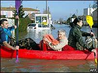 Military team evacuate an elderly woman in a canoe from a flooded Monplaisir suburb of Arles, on Sunday.