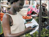 Woman using mobile in Senegal