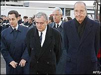 French Interior Minister Nicolas Sarkozy (l), Prime Minister Jean-Pierre Raffarin and President Jacques Chirac (r)