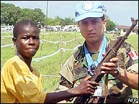 Child soldier with UN peacekeeper