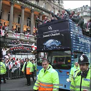 Andy O'Donnell snaps the England team bus 'Sweet Chariot' as it passed Her Majesty's Theatre, which sported a celebratory banner saying 'Phantastic'