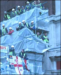 Rachel Jones spied these workmen on scaffolding taking a lengthy lunch to watch the parade