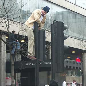 Norman Fisher took this man climbing a traffic light