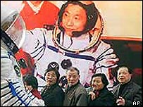 Visitors at an exhibition on Yang's mission