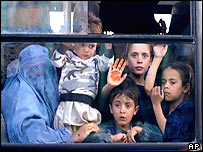 An Afghan family aboard a bus