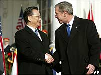 President Bush and China's Premier Wen Jiabao shake hands on the White House lawn