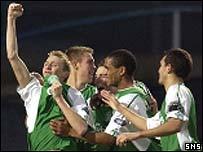 Derek Riordan celebrates with team-mates