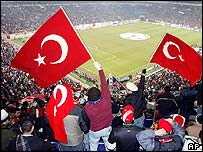 Supporters from Besiktas Istanbul wave Turkish flags