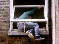 Robber in window