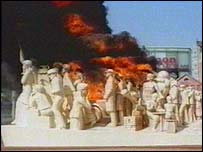 The Forward Statue on fire
