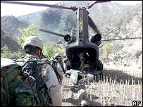 US troops board a helicopter in Afghanistan