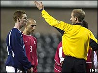 Referee Mike Riley sends off Stephen Pearson