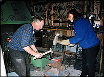 Blacksmith Nikolai Mitin with Bridget Kendall