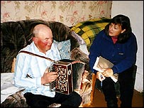 Anatoly Ptitsin, elderly accordion player, with Bridget Kendall