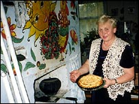 Former teacher Sofia Anatolievna with a homemade pie