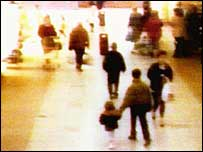 James Bulger being led away by his killers