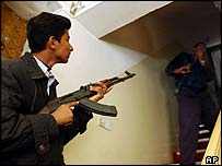 Iraqi police officers search a hotel during a raid searching for weapons, drugs and prostitutes in Baghdad