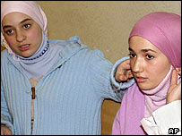 Two young French Muslim schoolgirls who were expelled from school for wearing headscarves