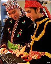 Malaysian men check their e-mail at the UN summit, AP