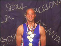 Sir Steven Redgrave shows off his five gold medals